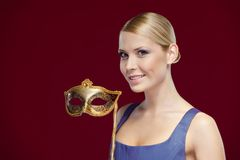 Beautiful woman with masquerade masque Stock Photos