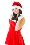 Beautiful woman in masquerade santa costume. Royalty Free Stock Photo