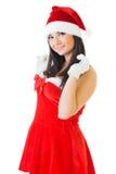 Beautiful woman in masquerade santa costume. Royalty Free Stock Photo