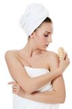 Beautiful woman with a massage brush. SPA concept. stock photo