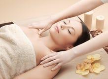 Beautiful woman in massage salon Stock Photos
