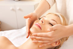 Beautiful woman in massage salon Stock Photos