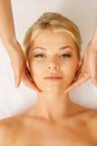 Beautiful woman in massage salon Stock Image