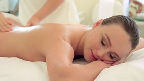 Beautiful woman massage in spa salon