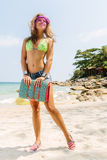 Beautiful woman with mat in tropics. Stock Photos