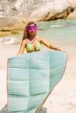 Beautiful woman with mat in tropics. Stock Image