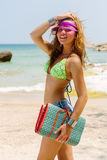 Beautiful woman with mat in tropics. Royalty Free Stock Image