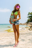 Beautiful woman with mat in tropics. Royalty Free Stock Photography
