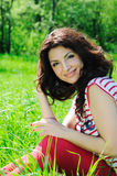Beautiful woman on meadow Stock Photo