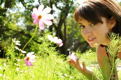 Beautiful woman in the meadow. The young beautiful woman in the meadow of chamomiles royalty free stock image