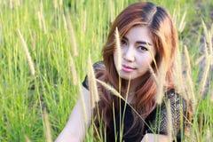 Beautiful woman in meadow grass. Portrait of asian. Stock Image