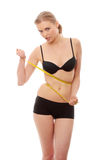 Beautiful woman measuring her body Royalty Free Stock Photography