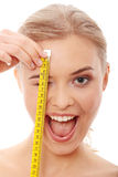 Beautiful woman measuring her body Royalty Free Stock Images