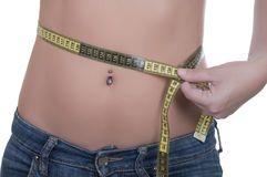 Beautiful woman measuring her waist Stock Image