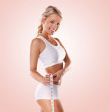 Beautiful Woman Measuring Her Waist Royalty Free Stock Photography