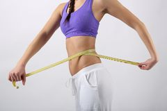 Beautiful woman measuring her waist Royalty Free Stock Photos