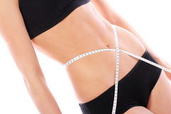 Beautiful woman measuring her waistline Royalty Free Stock Photo