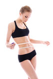 Beautiful woman measuring her waistline Stock Photo