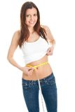 Beautiful woman measuring waist Royalty Free Stock Photos