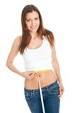Beautiful woman measuring waist Stock Images