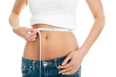 Beautiful woman measuring waist Royalty Free Stock Images
