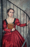 Beautiful woman in medieval dress with book Stock Images
