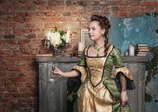 Beautiful woman in medieval dress with candelabrum Stock Images