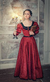 Beautiful woman in medieval dress with candelabrum Stock Image