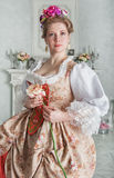 Beautiful woman in medieval dress holding rose Stock Photo