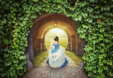 Beautiful woman in medieval dress on the mysterious road Royalty Free Stock Photography