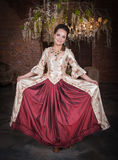 Beautiful woman in medieval dress smiling Royalty Free Stock Photo