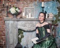 Beautiful woman in medieval dress Stock Photos