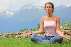 Beautiful woman is meditating. Royalty Free Stock Photo