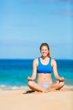 Beautiful woman meditating on the beach. In Hawai Stock Image