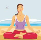 Beautiful woman meditating on the beach Stock Image