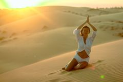 Beautiful woman meditating in desert Royalty Free Stock Photo