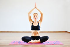 Beautiful woman meditating in lotus pose Royalty Free Stock Photography