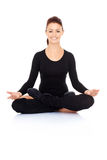 Beautiful woman meditating in the lotus position Stock Photo