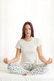 Beautiful woman meditating  in a room Stock Photos