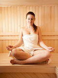 Beautiful woman meditating at sauna Royalty Free Stock Images