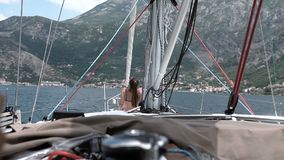 Woman meditating on yacht. Beautiful woman meditating on yacht stock footage