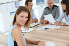 Beautiful woman in meeting with coworkers Stock Photography