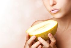 Beautiful woman with melon Stock Images
