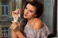 Beautiful woman with message in a bottle Stock Image