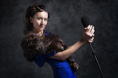 Beautiful woman with microphone Royalty Free Stock Photography