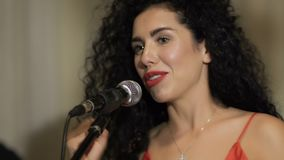 Beautiful woman with microphone finish concert stock footage