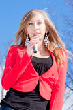Beautiful woman with a microphone in hands Stock Photo