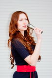 Beautiful woman with a microphone in hands Stock Photos