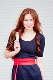Beautiful woman with a microphone in hands Royalty Free Stock Photos