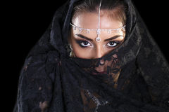 Beautiful Woman in Middle Eastern Niqab veil on isolated black b Royalty Free Stock Photos